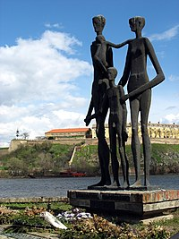 a sculpture in Novi Sad of three tall gaunt figures dedicated to the 1942 raid victims