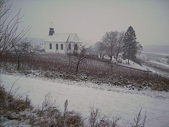 Gleiszellen-Gleishorbach - A wintry scene showing St. Dionysius, located on a hill between Gleiszellen and Gleishorbach