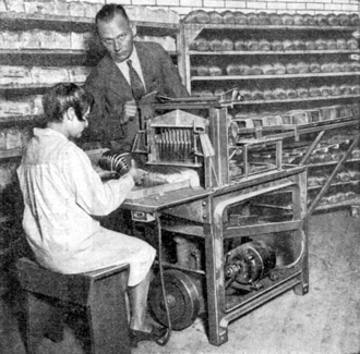 """Sliced bread - This photograph depicts a """"new electrical bread slicing machine"""" in use by an unnamed bakery in St. Louis in 1930 and may well show Rohwedder's machine in use by the Papendick Bakery Company"""