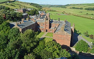 Edmund Grindal - St. Bees School, Cumbria, the Foundation block. The original Elizabethan school is the range on the left of the quad.