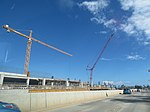 Starr-180126-1650-Cocos nucifera-view rental car garage and monorail construction and cranes-Kahului Airport-Maui (40290492611).jpg