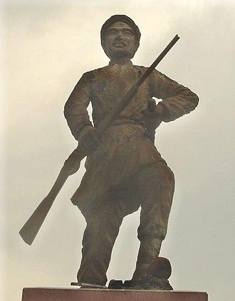 Phan Đình Phùng - A statue of Phan Đình Phùng located in center of the traffic circle facing the Cho Lon General Post Office, District 5, Ho Chi Minh City.