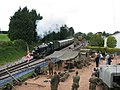 Steam train approaching Churston Station past the military display - geograph.org.uk - 1295583.jpg