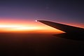 Sunset from the plane (2279981356).jpg