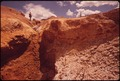 TAILINGS PILES AND BARREN LAND REMAINED AFTER A GOLD MILL WAS ABANDONED IN THE 1930's. THE LAND IS SO SATURATED WITH... - NARA - 543842.tif
