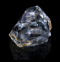 List of us state minerals rocks stones and gemstones wikipedia a light blue chunk of topaz cutting rough sciox Gallery