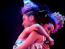 Twins hug each other on The Missing Piece Concert, 2006
