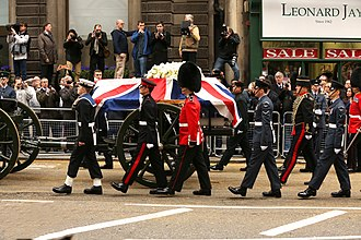 Gun carriage - Margaret Thatchers coffin being carried on a gun carriage, and escorted by her pallbearers.