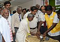 The District Collector, Theni District, Shri N. Venkatachalam overseeing a villager receiving money through Micro ATM system arranged at the media workshop on Post Demonetization - Taking Mobile and Digital Banking to Rural.jpg