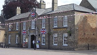 Whittlesey - The 18th-century George Hotel (now a Wetherspoons pub) decorated for the Queen's Diamond Jubilee in June 2012