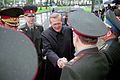 The Honorable Donald H. Rumsfeld, U.S. Secretary of Defense, is introduced to a Ukrainian Senior Officer with the Ministry of Defense staff at Kiev, Ukraine, on Jun. 5, 2001 010605-D-WQ296-013.jpg
