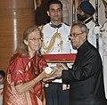 The President, Shri Pranab Mukherjee presenting the Padma Shri Award to Dr. Bettina Sharada Baumer, at a Civil Investiture Ceremony, at Rashtrapati Bhavan, in New Delhi on April 08, 2015.jpg
