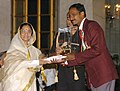 The President, Smt. Pratibha Patil presenting the Arjuna Award -2006 to Shri K. M. Binu for Athletics at a glittering function, in New Delhi on August 29, 2007.jpg