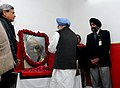 The Prime Minister, Dr. Manmohan Singh paying homage to the former Chief Minister of West Bengal, late Shri Jyoti Basu, in New Delhi on January 18, 2010.jpg