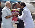 The Prime Minister, Shri Narendra Modi being received by the Governor of Andhra Pradesh and Telangana, Shri E.S.L. Narasimhan and the Chief Minister of Telangana, Shri K. Chandrasekhar Rao, on his arrival, in Telangana (1).jpg