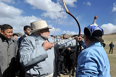 Indian Prime Minister Narendra Modi at Naadam in Ulaanbaatar The Prime Minister, Shri Narendra Modi trying his hand on archery at Mini Naadam Festival, in Ulaanbaatar, Mongolia on May 17, 2015.jpg