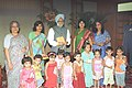 The Prime Minister Dr. Manmohan Singh with the young children who tied Rakhi to him during the auspicious occasion of 'Raksha Bandhan', in New Delhi on August 19, 2005 (4).jpg