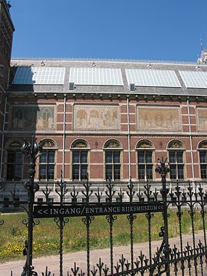 """Quellinusschool - Tile panels and window reliefs on the west wall of the Rijksmuseum, Amsterdam, from Cuypers' """"Quellinusschool"""" workshop"""
