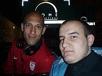Vujcic in 2009 (left) and with Tim Howard in 2012 (right).