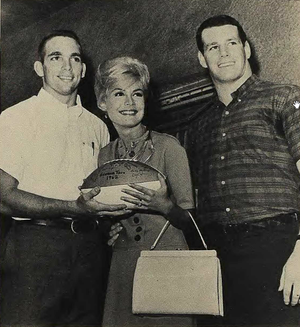 Larry Stallings - Stallings (right) and teammate present football to Miss Sandra Dee, 1962