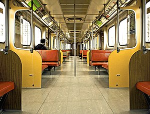 H-series (Toronto subway) - Interior of an H4 subway car. The H4s had a similar interior design similar to that of the H2 subway cars but had less seating to allow for more passengers. The H4s were the last H-series cars to have large padded bench seats. The H2 and H4 cars had beige doors, yellow panels, orange padded seats, dark brown walls and light brown floors. These were the last Toronto subway car models not equipped with air-conditioning systems.