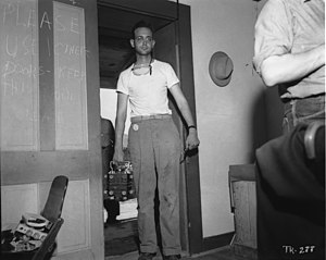 McDonald Ranch House - Sergeant Herbert Lehr, whose informal dress reflects the McDonald House's sweltering conditions in July 1945, delivered the plutonium core for the bomb in a shock-mounted carrying case
