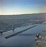 Tug towing logs under Aurora Bridge, 1968.jpg