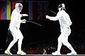 U.S. Air Force Capt. Seth Kelsey, left, competes in the Olympic men's epee individual bronze medal fencing match against Jung Jinsun from South Korea 120801-A-ZZ999-002.jpg