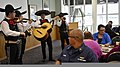 U.S. Coast Guardsmen and civilian personnel listen to a mariachi band while attending a Hispanic Heritage Month event at Coast Guard Station Miami Beach, Fla., Oct. 13, 2011 111013-G-KU792-036.jpg