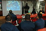 U.S. Navy Chief Engineman Cordon Phillips, standing, facilitates a presentation about the Battle of Midway aboard the guided missile destroyer USS Curtis Wilbur (DDG 54) during Cooperation Afloat Readiness 130607-N-AX577-521.jpg