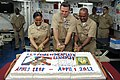 U.S. Navy Chief Operations Specialist Dennisha McElveen, Command Master Chief Steven Alt and Chief Aviation Machinist's Mate Michael Paul cut a cake during a celebration of the 119th anniversary of the chief 120401-N-KD852-031.jpg