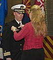 U.S. Navy Cmdr. Michael Yesunas, left, receives his command pin from his wife, Susan, during a change of command ceremony March 28, 2013, aboard the dry cargo-ammunition ship USNS Richard E. Byrd (T-AKE 4) 130328-N-ZF573-111.jpg
