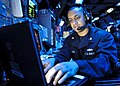 U.S. Navy Operations Specialist 2nd Class Victor Sellers stands the tactical information coordinator watch in the combat information center aboard the guided missile cruiser USS Shiloh (CG 67) in the South China 130527-N-KB052-363.jpg