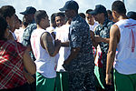 U.S. Sailors and the Samoan Don Bosco Long Boat Rowing Team shake hands on the flight deck aboard the amphibious dock landing ship USS Pearl Harbor (LSD 52) after both sides accept a long boat rowing race 130604-N-WD757-889.jpg