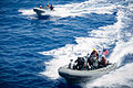 U.S. Sailors assigned to the guided missile destroyer USS Stockdale (DDG 106) maneuver rigid-hull inflatable boats alongside the ship during small-boat operations in the U.S. 5th Fleet area of responsibility 130522-N-HN991-033.jpg