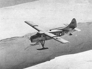 Ellsworth Station - A U.S. Navy de Havilland Canada UC-1 Otter of Antarctic Development Squadron 6 (VXE-6) in flight over a large opern crevasse near Ellsworth Station, Antarctica, in 1958