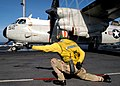US Navy 031106-N-9563N-502 A Shooter signals a C-2A Greyhound to launch from the flight deck aboard USS Theodore Roosevelt.jpg