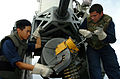 US Navy 041018-N-0841E-147 Fire Controlman 3rd Class Nat Sakolpas, left, of Long Beach, Calif., is assisted by Fire Controlman 3rd Class Eric Hatchett of Lebanon, Ohio, while loading a Close-In Weapons System (CIWS).jpg