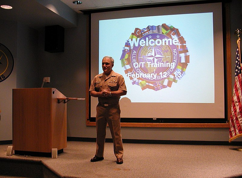 File:US Navy 050212-N-8268S-030 Commanding Officer, Supreme Allied Command-Transformation (SAC-T), Detachment One One Three, Capt. Cal Bagby, welcomes students to NATO Observer-Trainer Training held at Air National Guard Base Battle.jpg