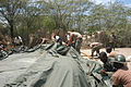 US Navy 050416-N-0507C-015 Members of Task Force New Horizons and local Haitians work together to assemble a tent in Gonaives, Haiti.jpg