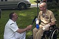 US Navy 050611-N-7184W-017 Journalist 2nd Class Mark Richardson, assigned to Naval Media Center Reserve Component, interviews Senior Chief Builder Robert M. Westover, Jr., at a welcome home ceremony.jpg