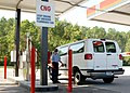 US Navy 050817-N-8544C-003 Photographer's Mate 3rd Class David Didier utilizes the base refueling facility to refuel a government vehicle with compressed natural gas (CNG).jpg