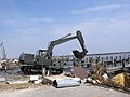 US Navy 050902-N-0000X-018 A U.S. Navy Seabee uses a track hoe to remove debris from Hurricane Katrina near the marina on board on board Naval Construction Battalion Center (NCBC) Gulfport, Miss.jpg