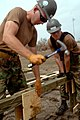 US Navy 050924-N-2653P-018 U.S. Navy Builder 3rd Class Gary Blank, assigned to Naval Mobile Construction Battalion Four (NMCB-4), helps assemble the foundation for the first of 75 temporary housing shelters in Pass Christian, M.jpg