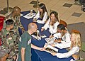 US Navy 051118-N-1027J-020 Military personnel wait in line as the NFL's Oakland Raider's Cheerleaders conduct a free autograph and photo session promoting the pre-sale of 2006 Pro Bowl tickets.jpg