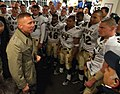 US Navy 051203-N-2383B-930 Commandant of the Marine Corps Gen. Michael W. Hagee congratulates the Navy team following a 42-23 win over the Black Knights of Army.jpg