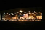 US Navy 060112-N-8726C-001 Sailors assigned the Tridents of Patrol Squadron Two Six (VP-26) head back to the hanger after conducting a pre-flight checks on a P-3C Orion