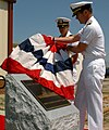 US Navy 060424-N-5330L-175 Commodore, Regional Support Organization Norfolk, Capt. Brian Goulding unveils a plaque dedicated to the memory of the coastal patrol boat USS Firebolt (PC 10).jpg