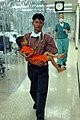 US Navy 060529-N-2832L-012 A man carries his son from the intensive care unit aboard the U.S. Military Sealift Command (MSC) hospital ship USNS Mercy (T-AH 19).jpg
