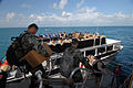 US Navy 070621-N-8704K-012 U.S. military members board a catamaran boat used to transport crew and patients from the anchored Military Sealift Command hospital ship USNS Comfort (T-AH 20) to conduct missions in Belize.jpg
